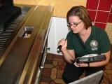 Restaurant Inspector Ensuring Fixtures Work Properly