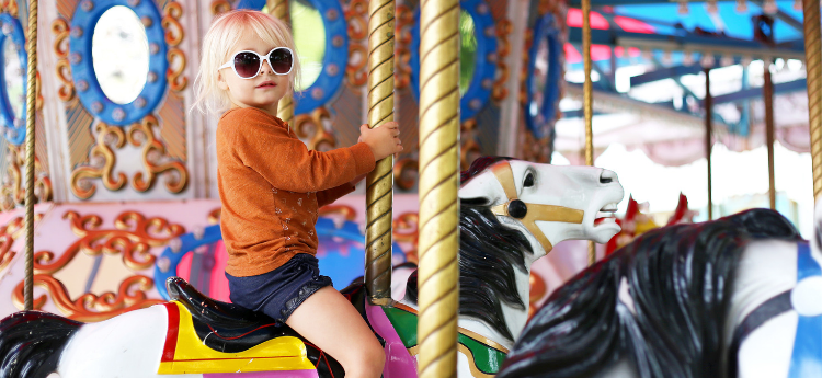 Female child on a carousel