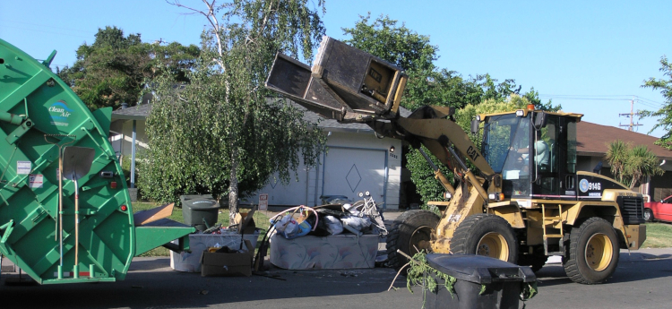 Heavy Equipment Picking Up Bulky Waste in Sacramento County